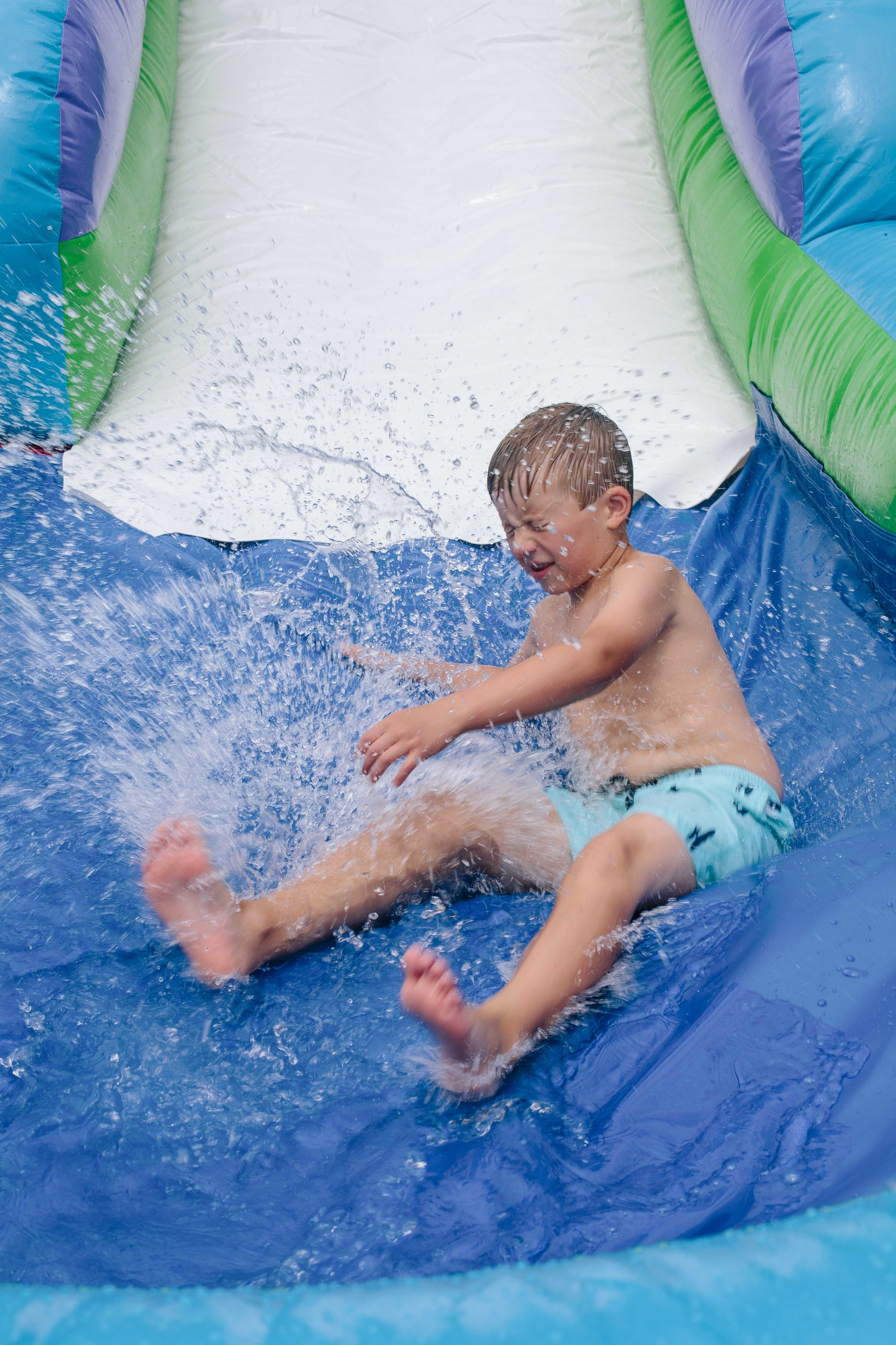 Big brother had fun all afternoon on the jump house water slide with the other big kids!