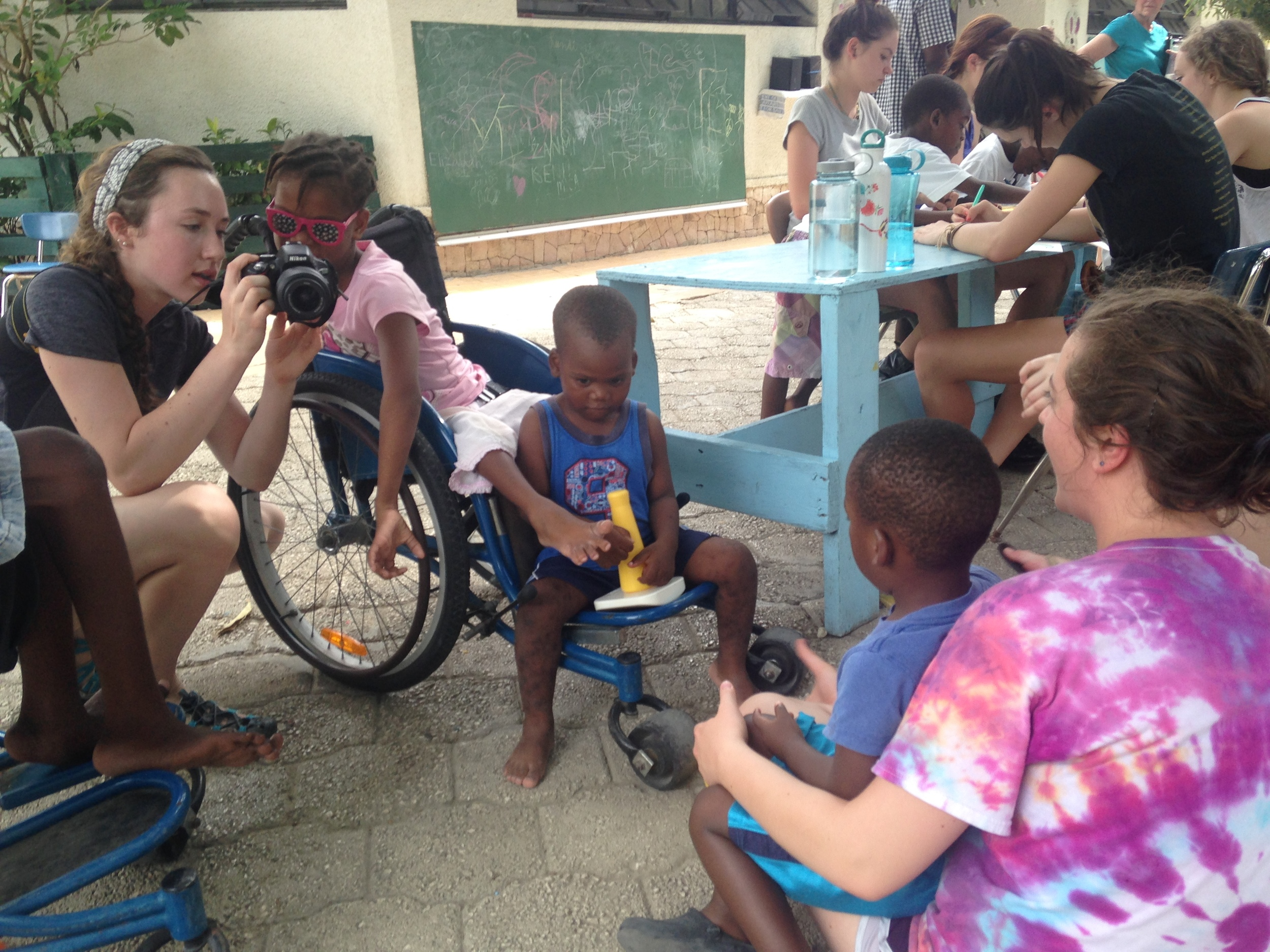 Jonathan and students working with Partners in Health in our annual Haiti orphanage project.