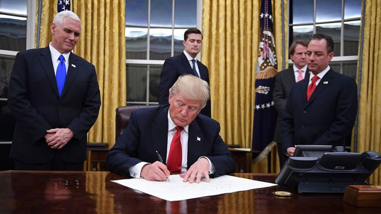 Within hours of taking the oath of office, President Donald Trump on Friday night signed an executive order aimed at trying to fulfill one of his most impassioned campaign promises: Rolling back Obamacare.