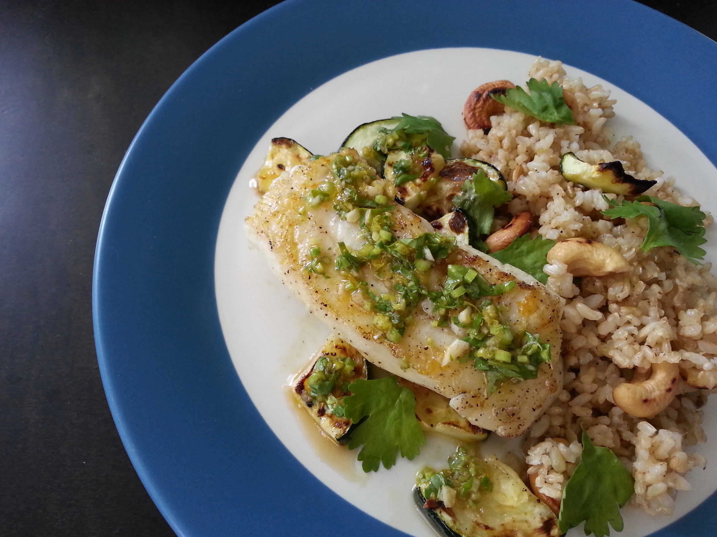 pacific cod with green sauce    cashew rice, zucchini, cilantro, lime