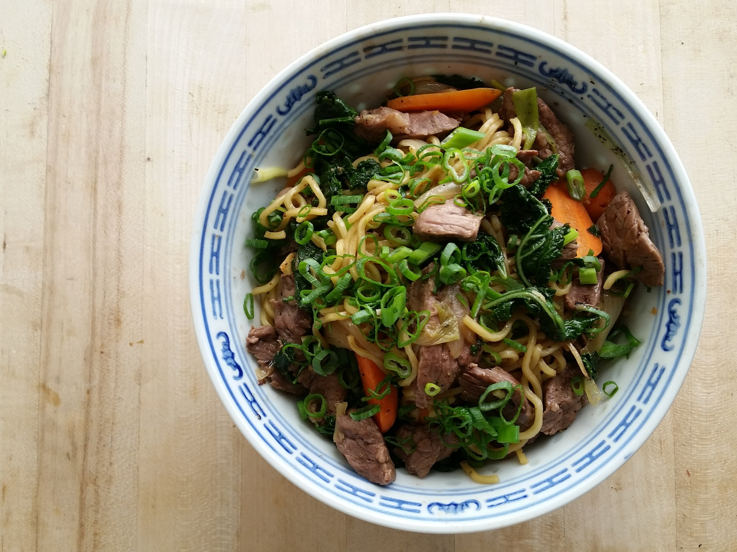 ginger beef over curried noodles    top round, yakisoba, market vegetables