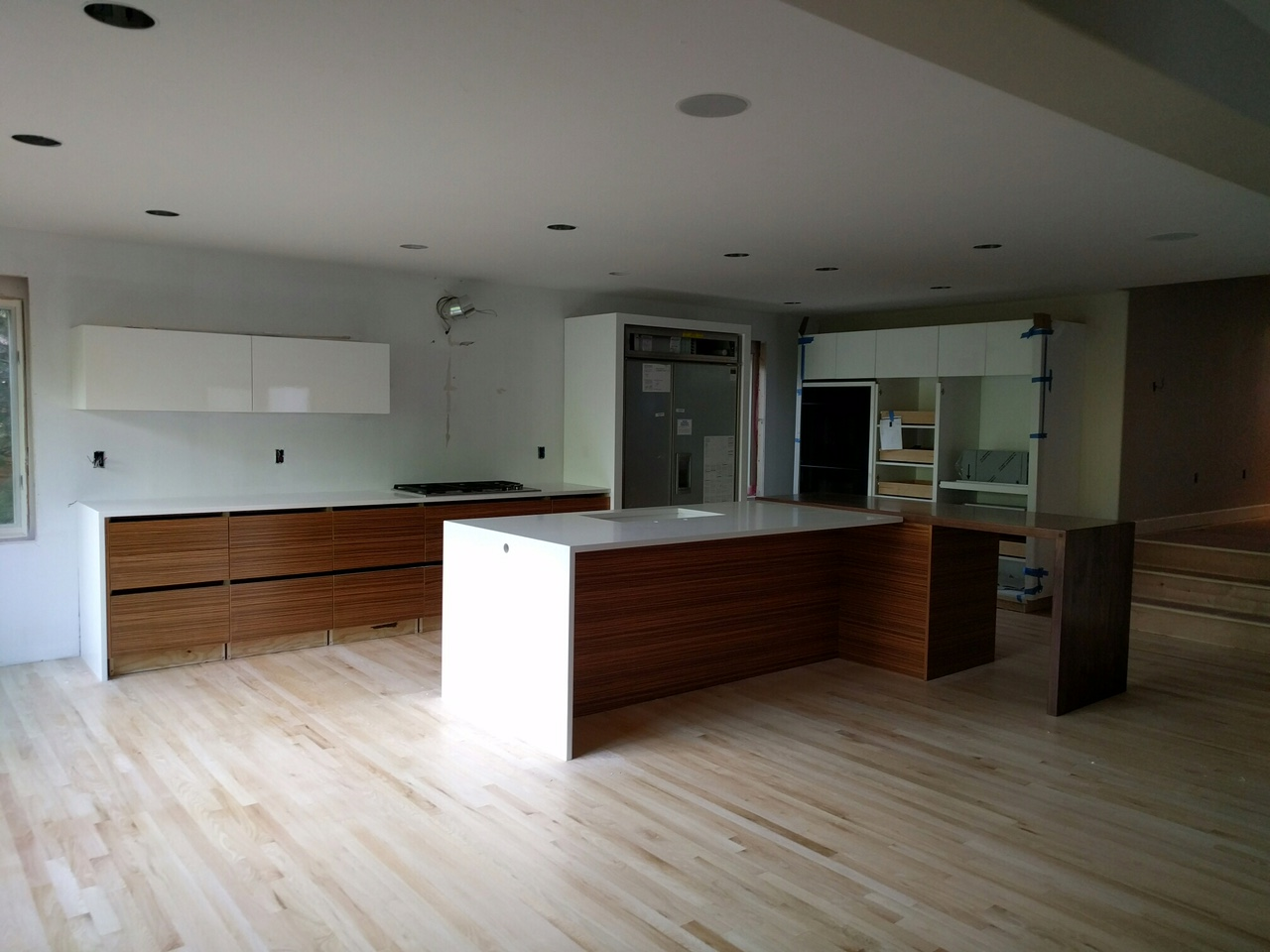 The kitchen is nearing completion. Next up: white backpainted tempered glass backsplash (large panels), appliance paneling, plumbing and electrical trim...