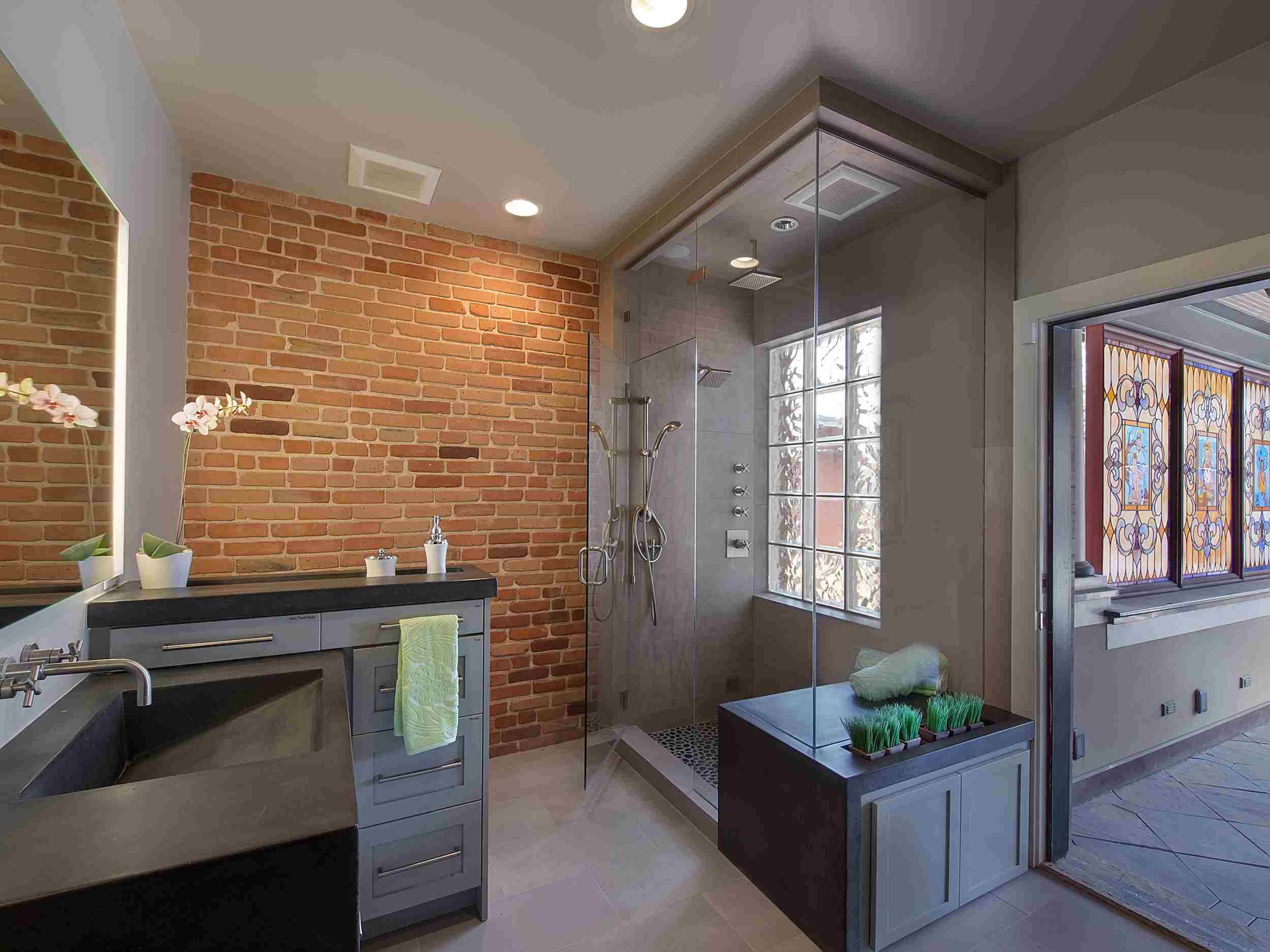 exposed brick and concrete — sanctuary kitchen and bath desi-1.jpg