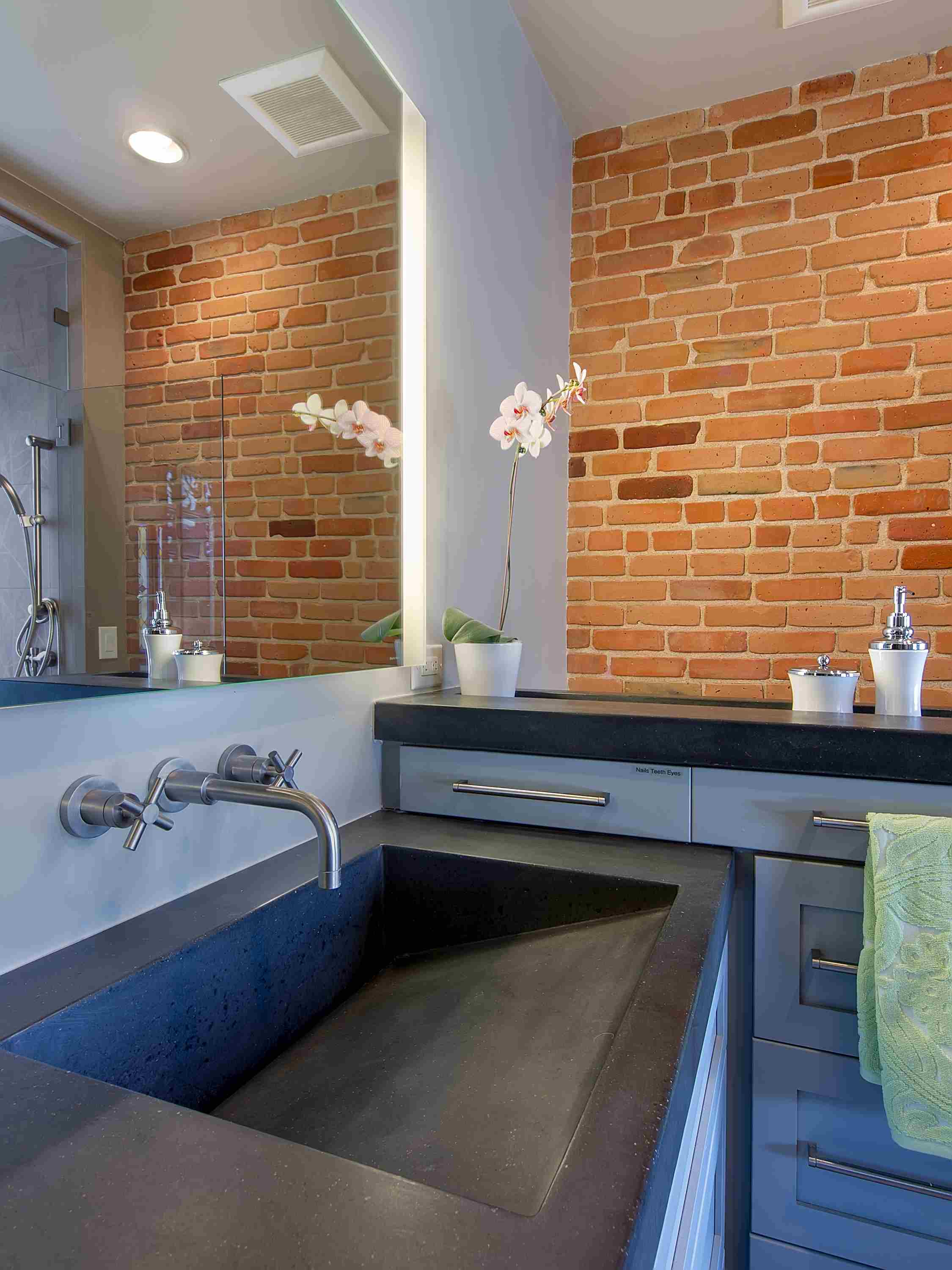 exposed brick and concrete — sanctuary kitchen and bath desi-3.jpg