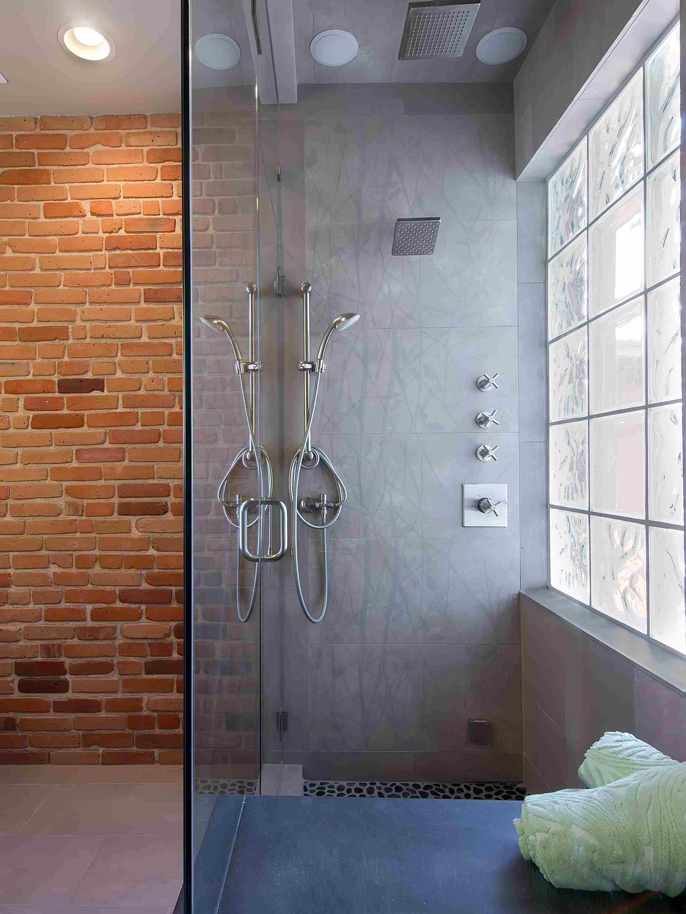 exposed brick and concrete — sanctuary kitchen and bath desi.jpg