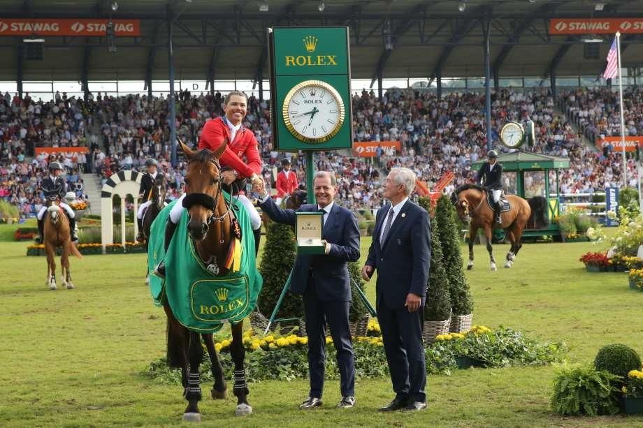 Rafael Rolli CEO Rolex Deutschland GmbH congratulates Kent Farrington