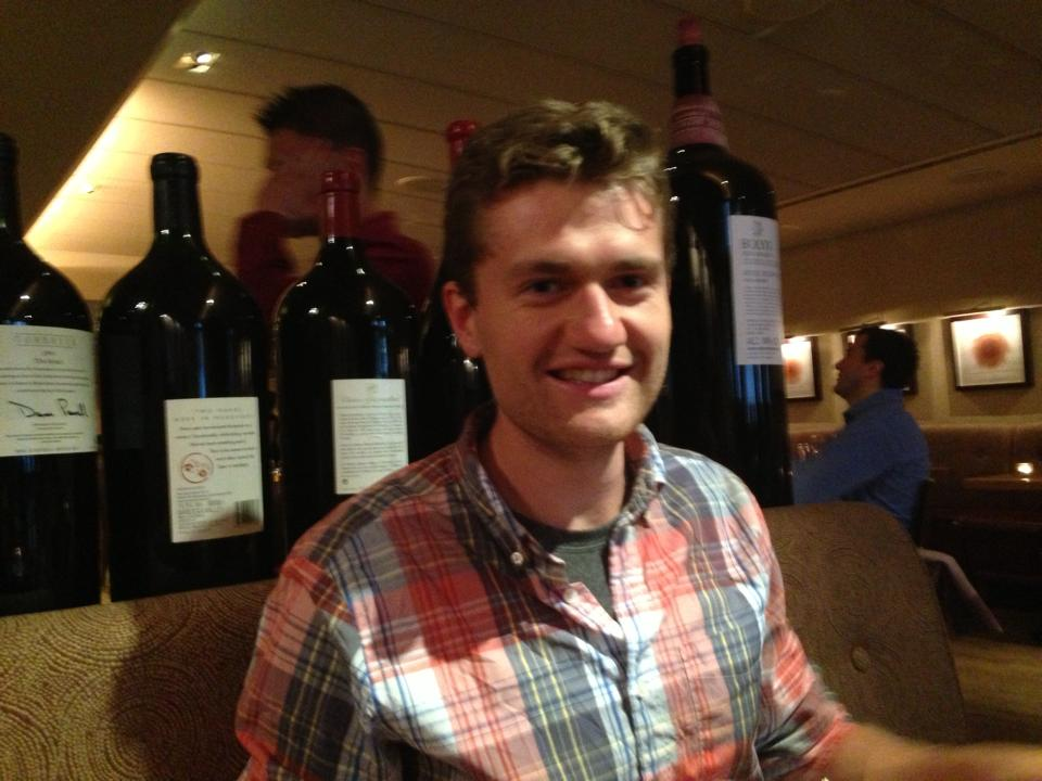 Patrick at Bar Boulud with the big bottles of wine