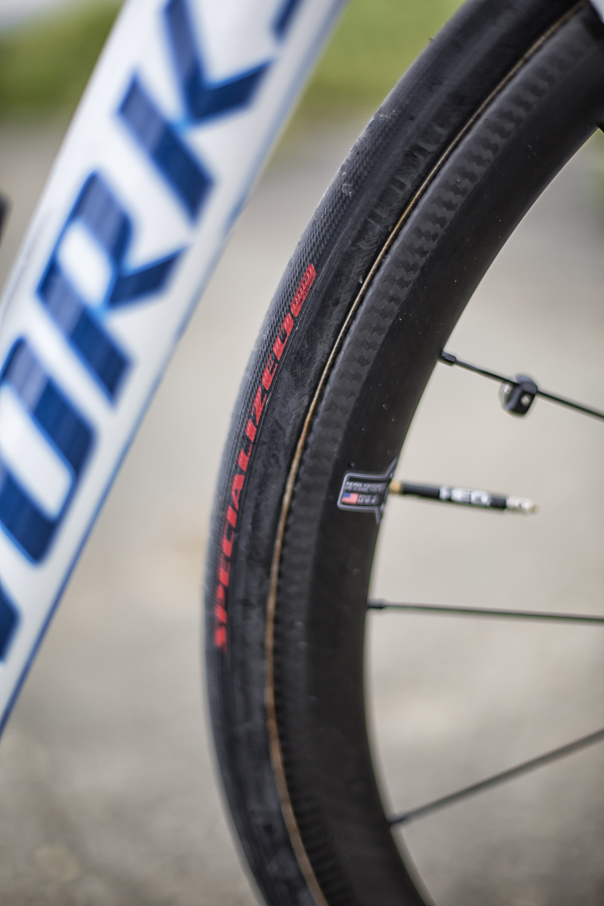 I race exclusively on 26mm tubulars, I am more confident in corners and believe the smoother ride keeps my body fresh for the run