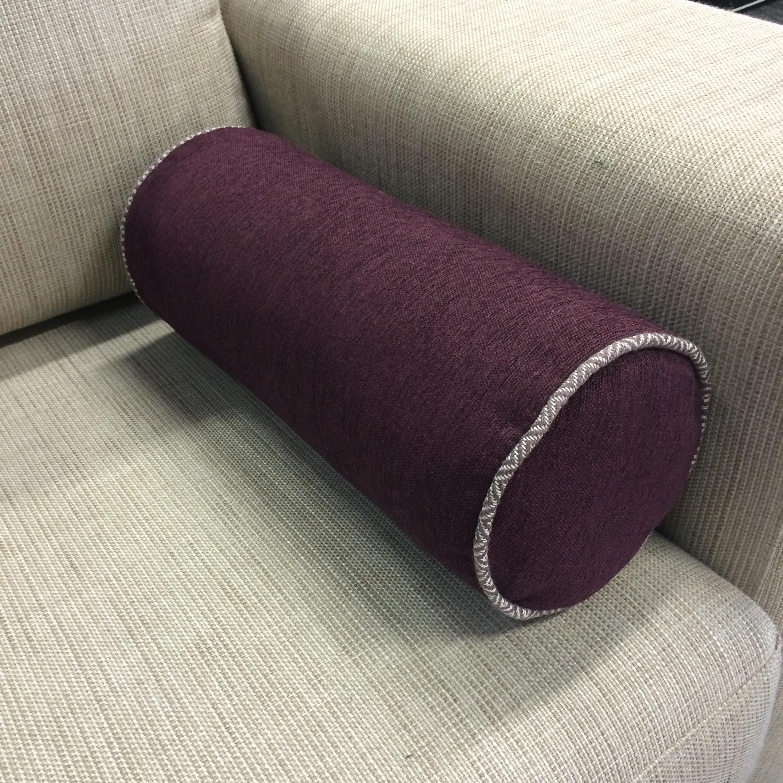 $114 ea  Size: Bolster  Fabric: Wright Aubergine