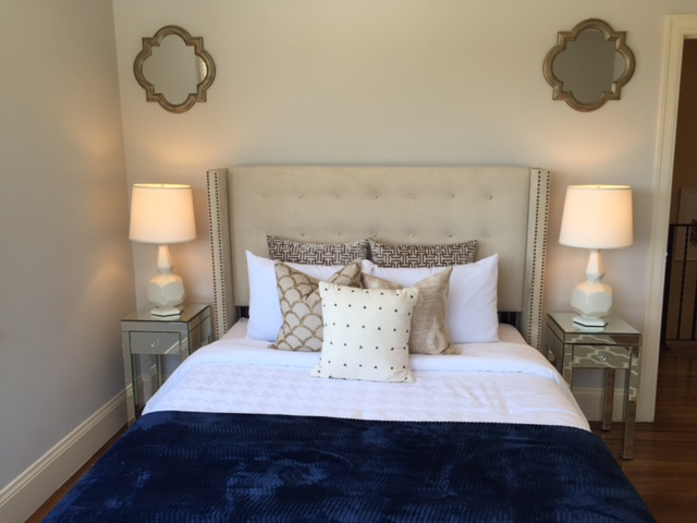 A bedroom was decorated to symmetrical perfection.