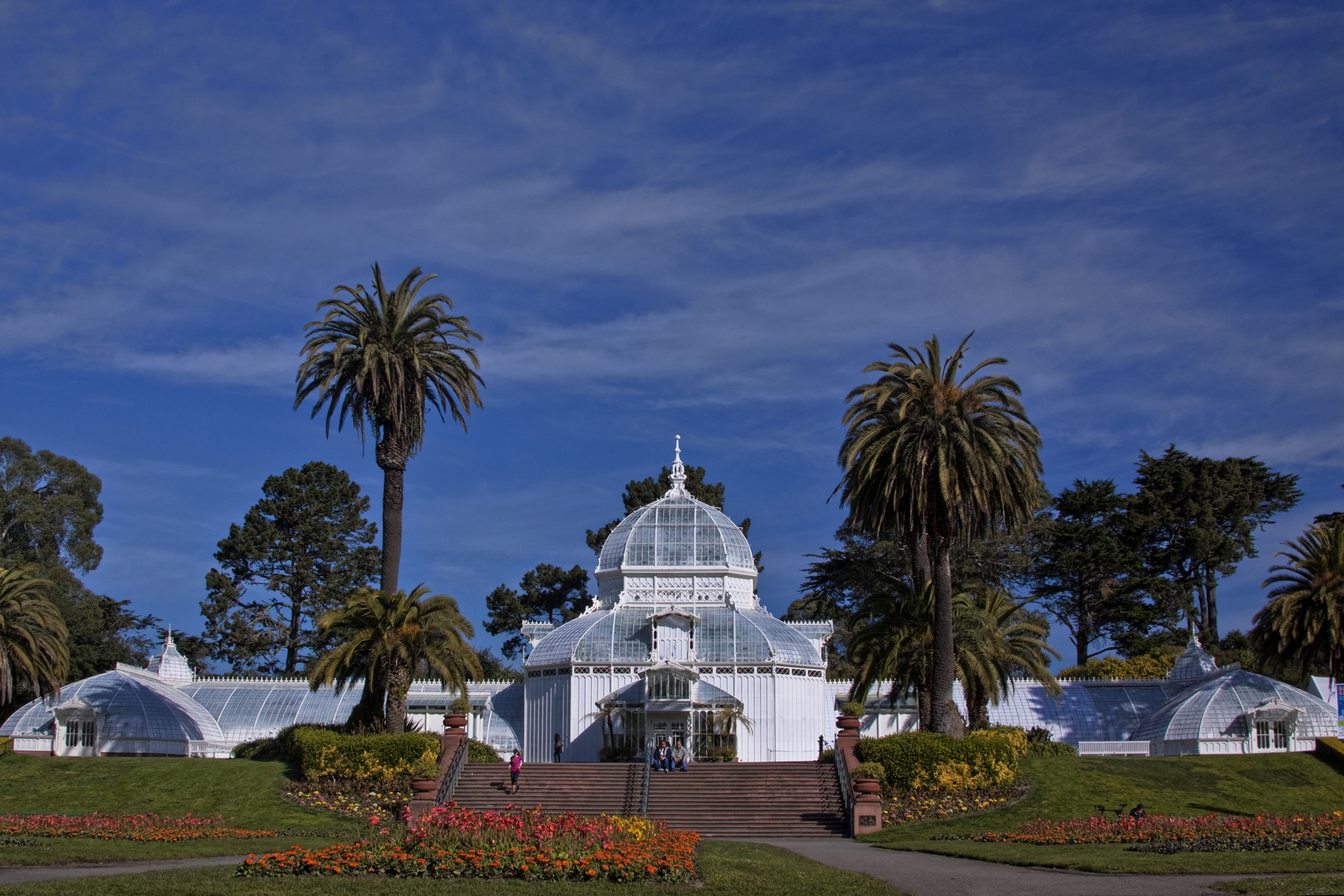 The nearby Conservatory of Flowers is a colorful meeting spot in Golden Gate Park.
