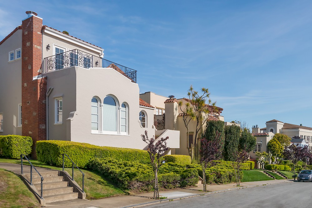 Beautiful Mediterranean-style homes with manicured front lawns line the streets of Balboa Terrace.