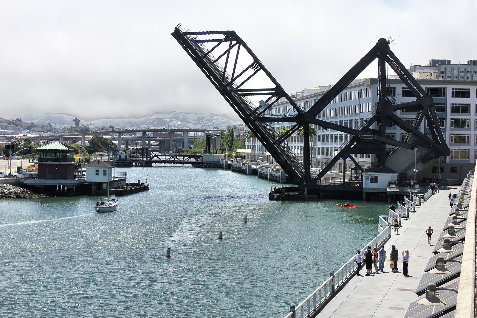 """The Fourth Street Bridge and the Francis """"Lefty"""" O'Doul Bridge are both working drawbridges designed by J.B. Strauss, whose firm, the Bascule Bridge Co., later designed the Golden Gate Bridge."""