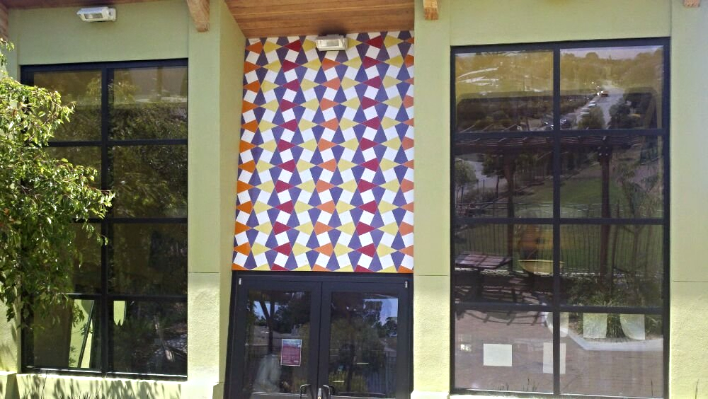 The clubhouse at Junipero Serra Playground is adorned with ceramic tile murals by San Francisco artist Laurey (Bean) Finneran.