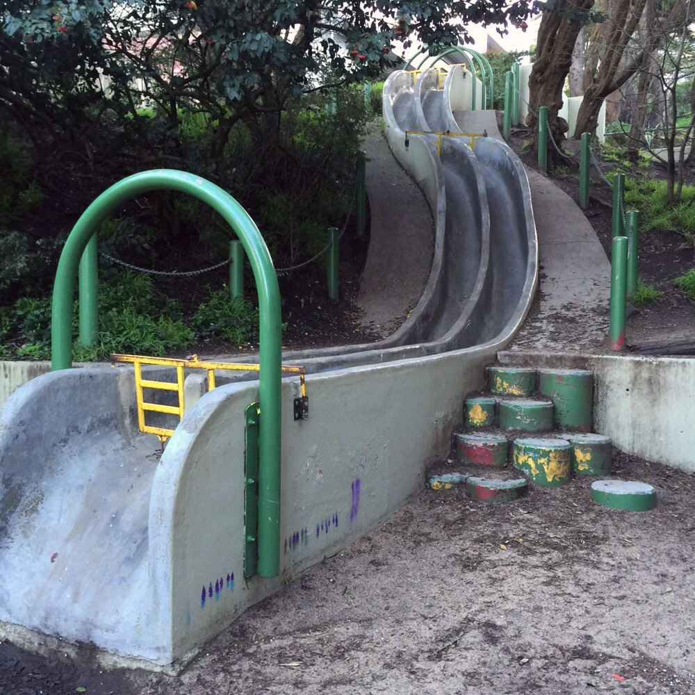 Seward Mini Park is a tucked-away gem featuring concrete children's slides and a community garden.