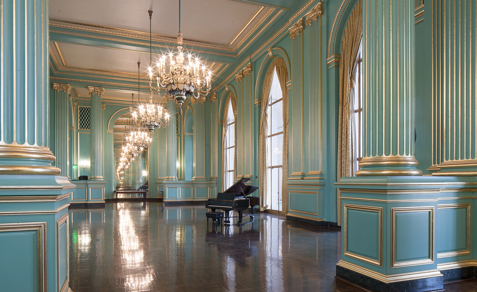 Known for its distinct color, soaring ceiling, and Beaux-Arts architecture, the Green Room hosts more than 200 functions a year.