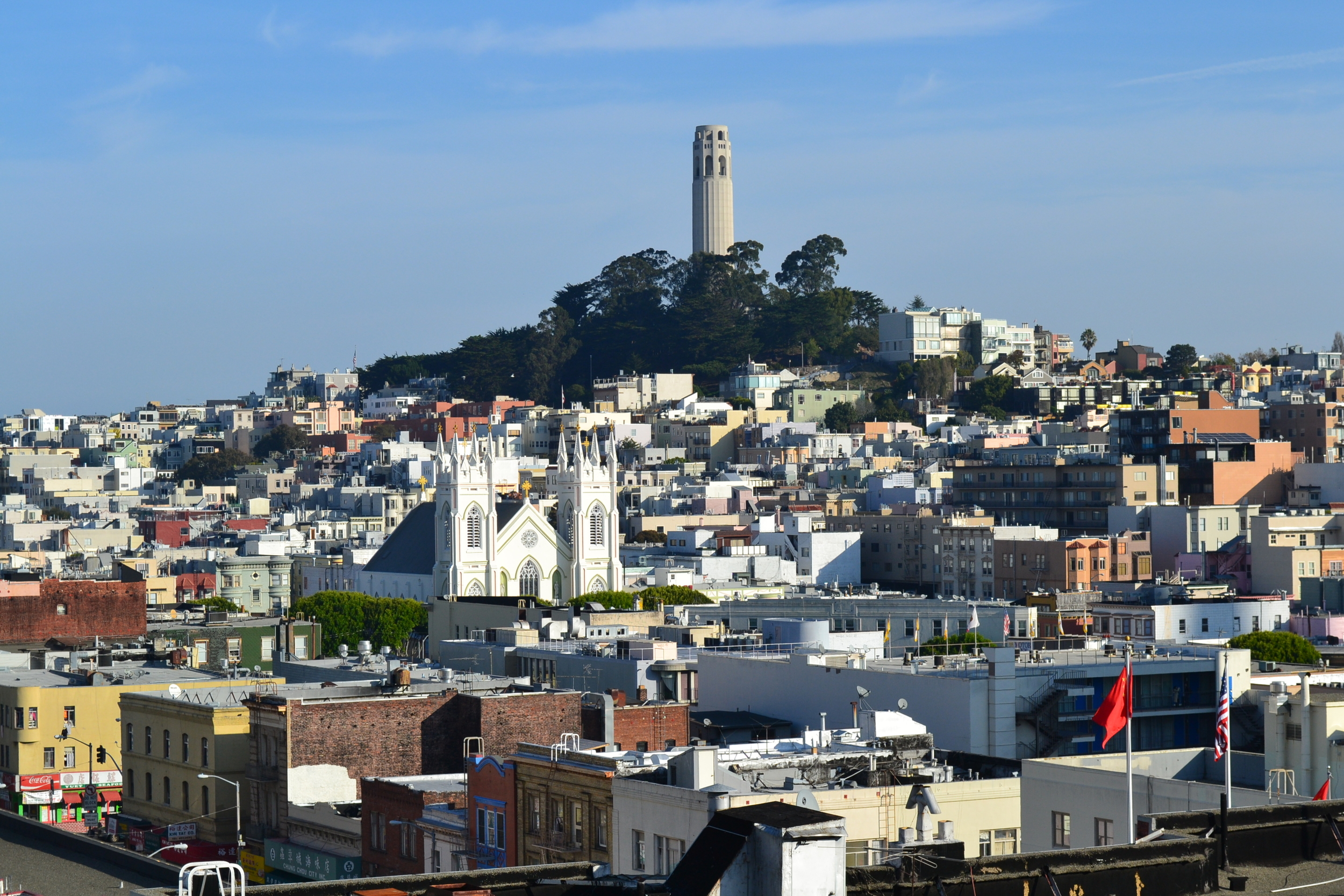The iconic Coit Tower rises high above the neighborhood, with sweeping views of the city and bay.