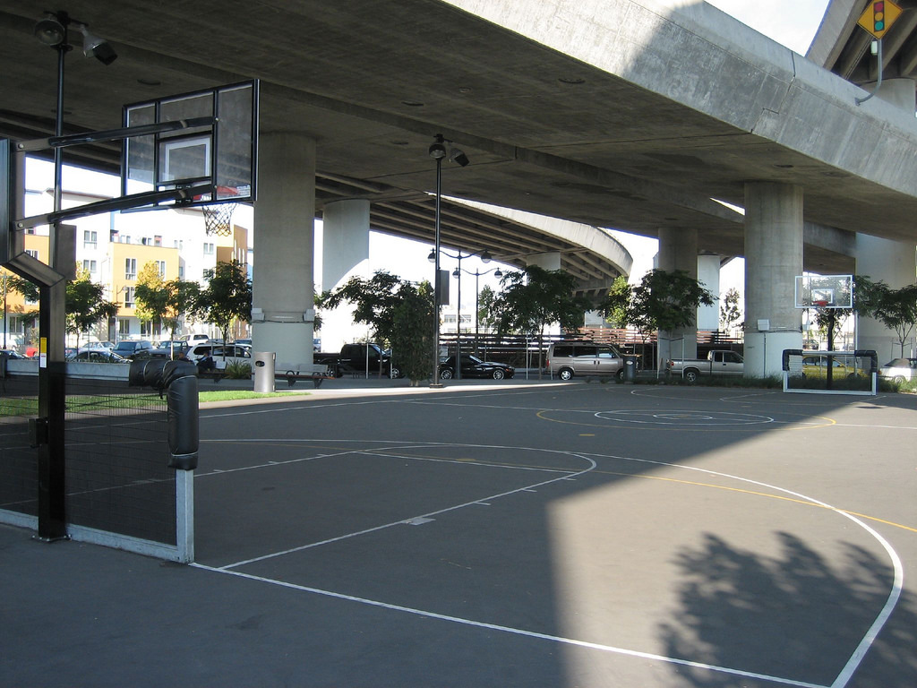 Hidden among the big buildings and overhead freeways, Mission Creek Park is a pleasant place for strolling and dog walking. Besides benches and grassy knolls, it has a boat launch area, kayaks, and courts for tennis, basketball, and volleyball.