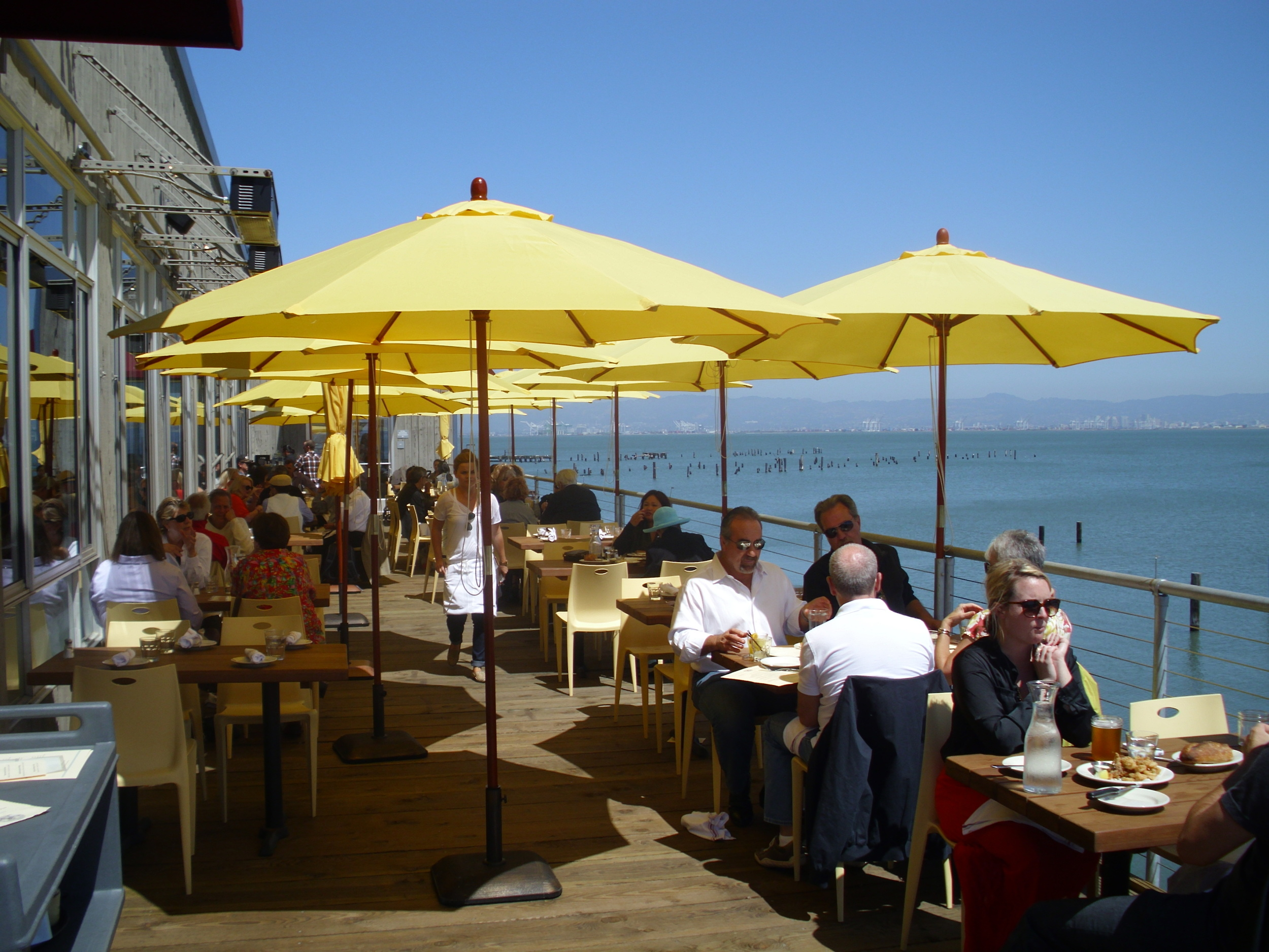 Mission Rock Resort is a bi-level seafood restaurant with an oyster bar and decks overlooking the bay.