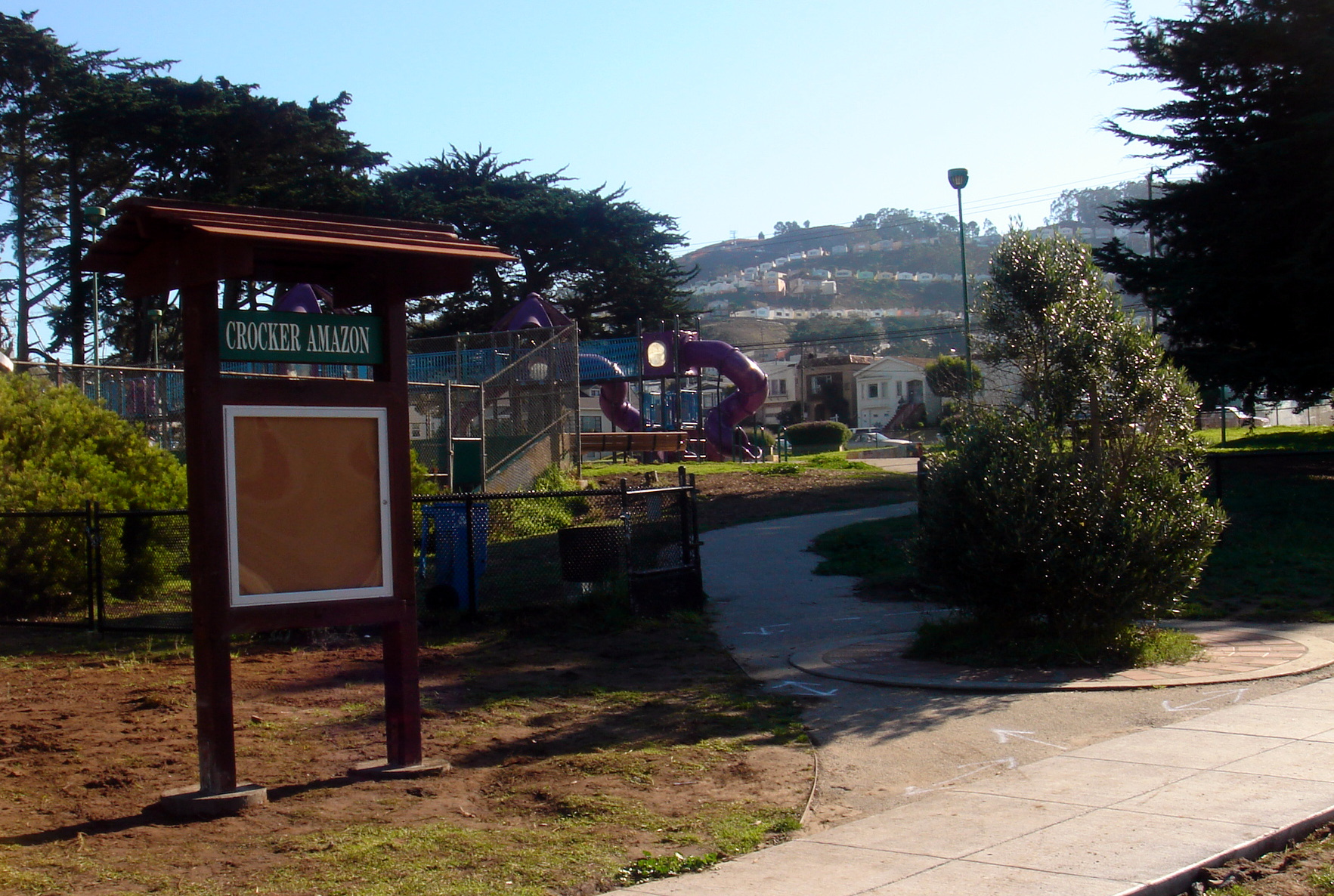 Crocker-Amazon Park has a play structure, sports fields, tennis and basketball courts, a recreation center, bocce court, picnic tables and playground.