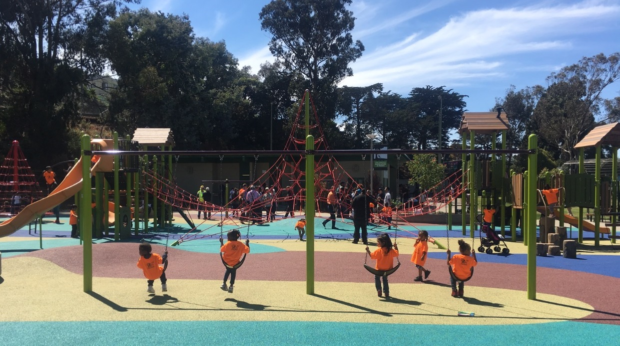 Gilman Park has a children's playground, grassy areas, a basketball court, and picnic tables.