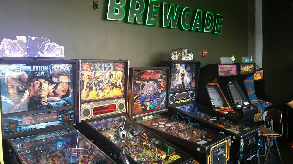 Brewcade - the arcade place with vintage video-games machines in the neon-decked space.