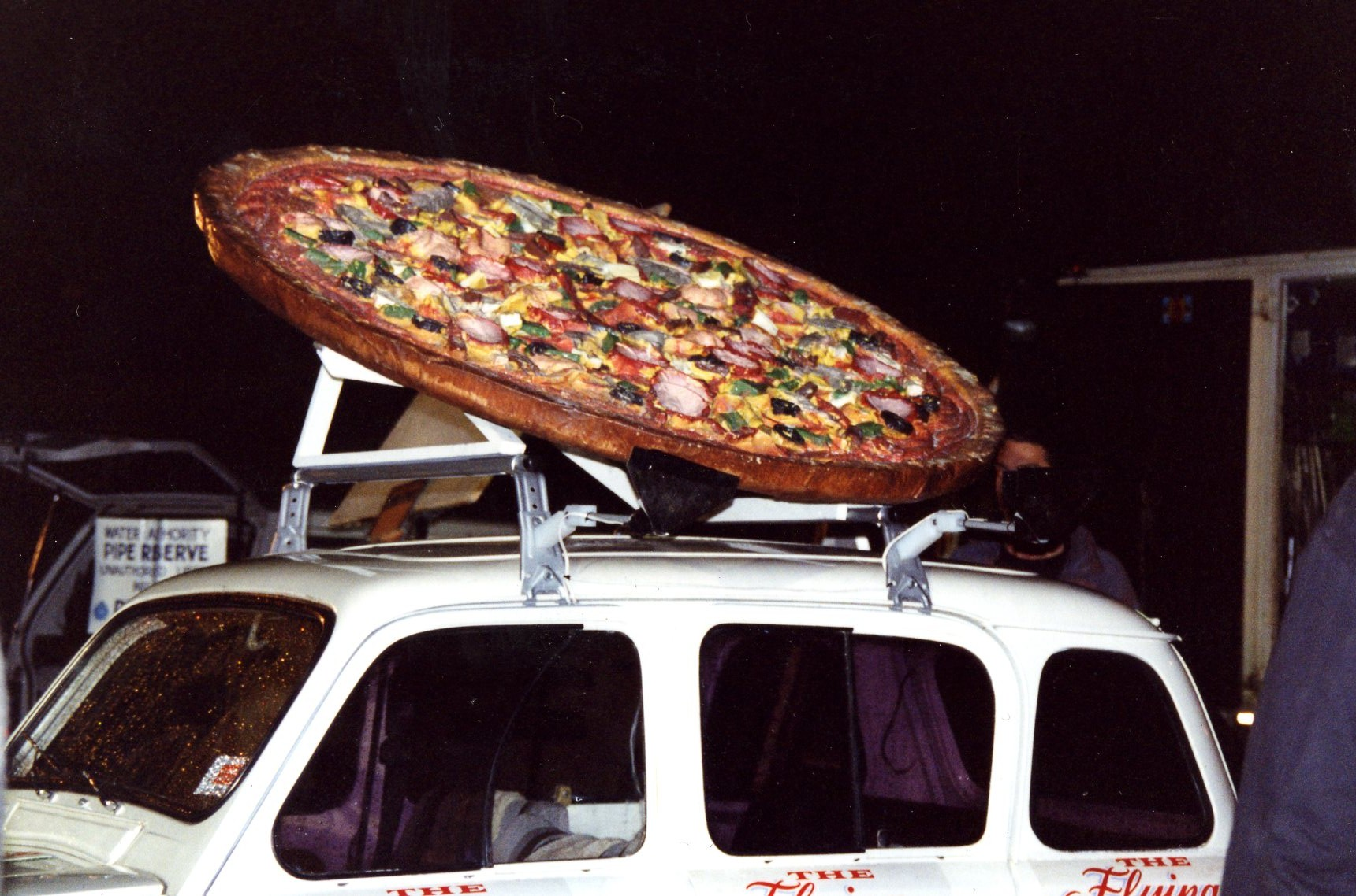 This pizza could fly off the roof of the car !.jpg