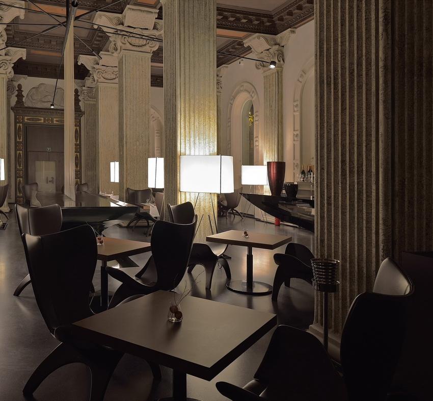 Lounge Bar - tables, lamps, armchairs (foreground), table fountain and bar couter (background)