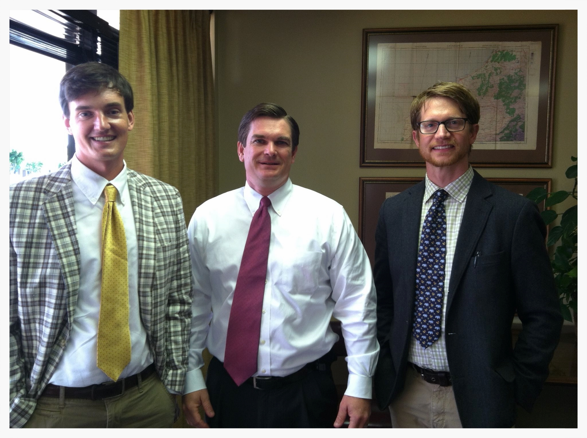 Donn Cooper, U.S. Representative Austin Scott, and Michael Wall, Georgia Organics Director of Programs