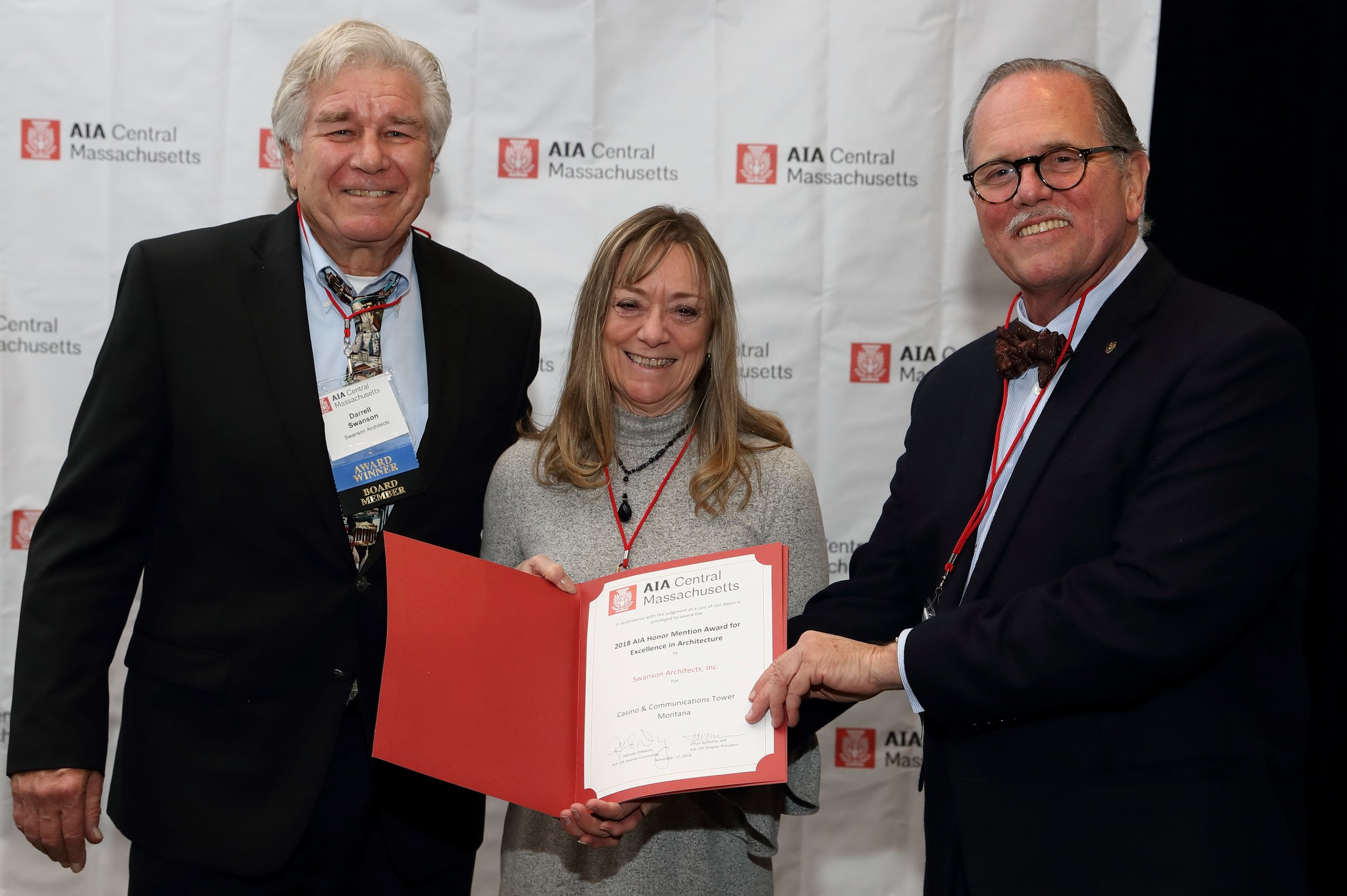 Darrell Swanson, of Swanson Architects Inc., received the AIACM Honor Mention Award for Excellence in Architecture. Pictured from left: Darrell Swanson, Martia Swanson and Ethan Anthony.
