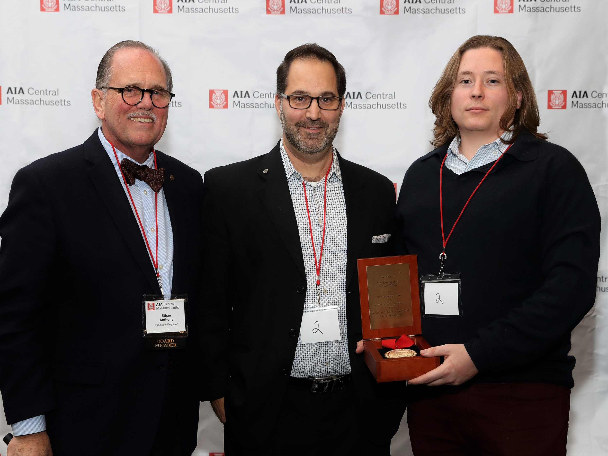 The first AIACM Presidential Medallion was presented to Jamie Walsh in honor of his late father Massachusetts Representative Chris Walsh. Pictured from left: Ethan Anthony, John Nunneri and Jamie Walsh.