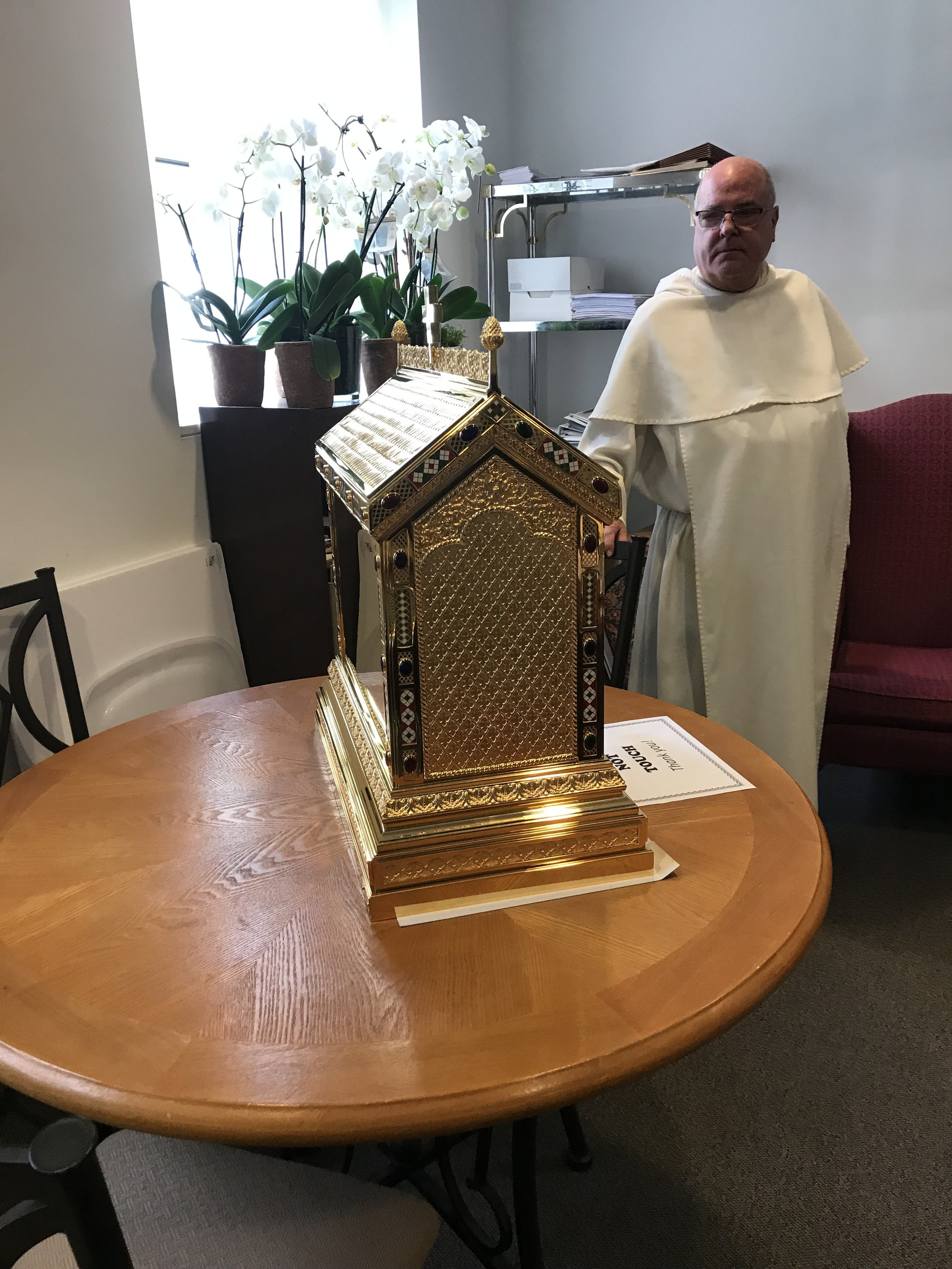 Father Barranger with the new Tabernacle for the church, handmade in Spain.