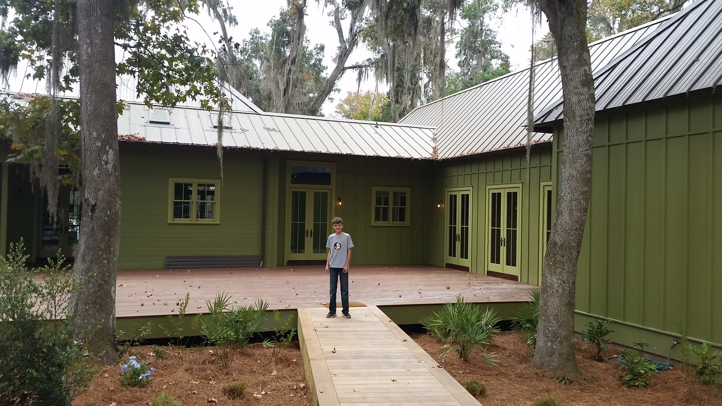 Our son posing at the custom home project