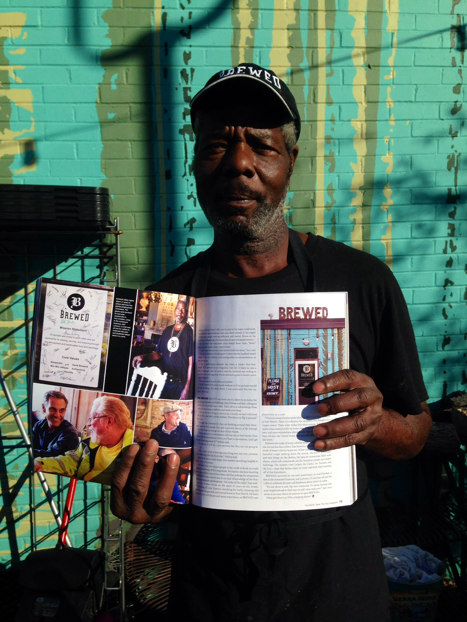 Kenneth Wiley proudly holding up his copy of Fort Worth Magazine.