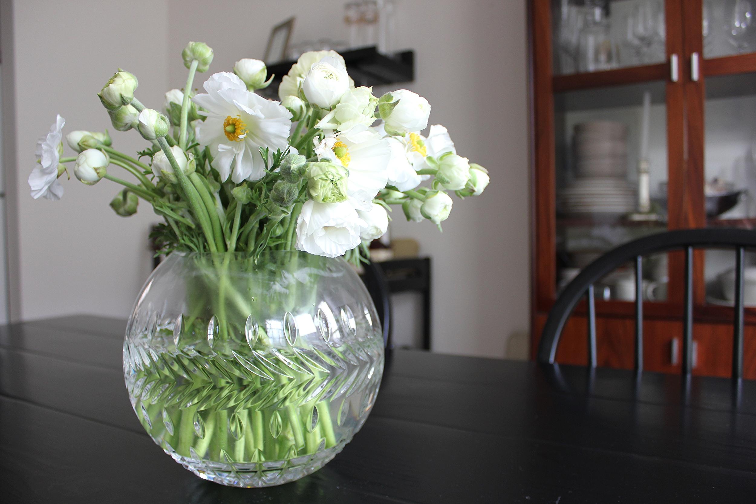 White ranunculus in a crystal vase