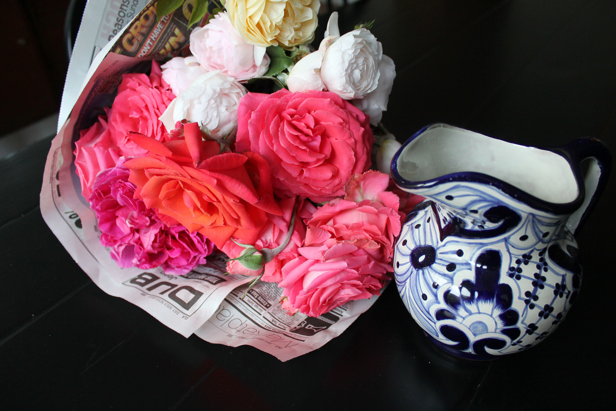 Decor for #cincodemayo - Pink and coral flowers in talavera pitcher - www.fancycasual.com