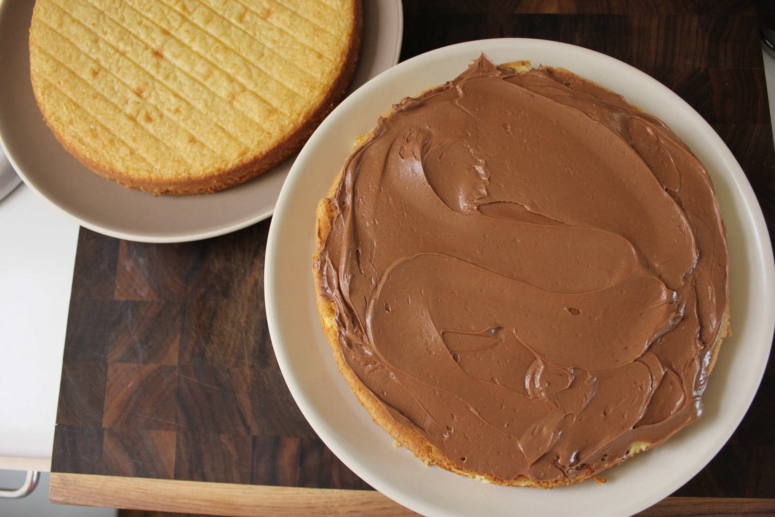 Classic yellow cake with chocolate frosting #dessert #BarefootContessa - www.fancycasual.com
