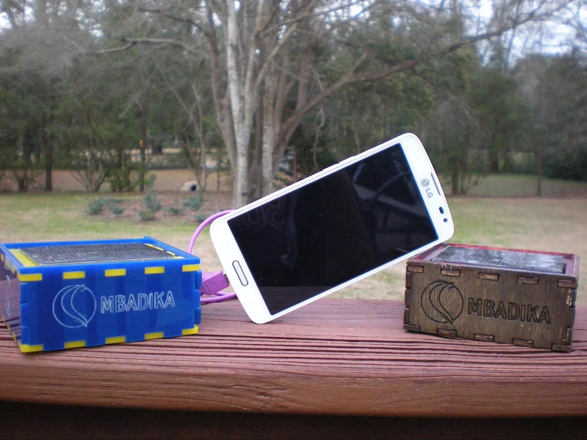 The Mbadika DIY Solar USB Charger Kit, Acrylic and Plywood Versions.