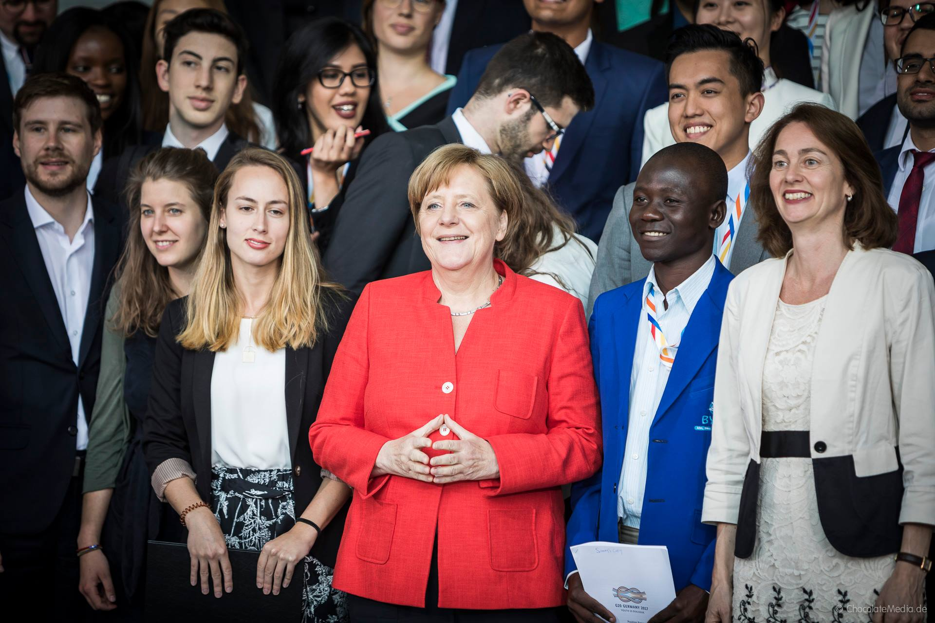 Samuel and others with Angela Merkel at Youth 20 Dialogue