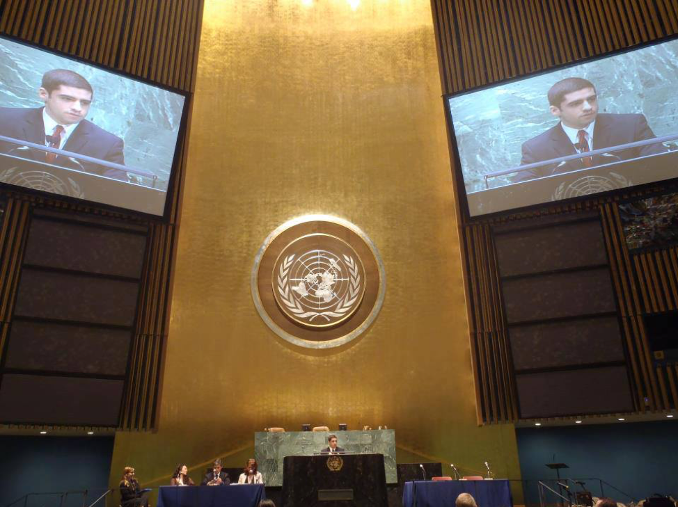 Sam Vaghar speaking in the United Nations General Assembly Hall.