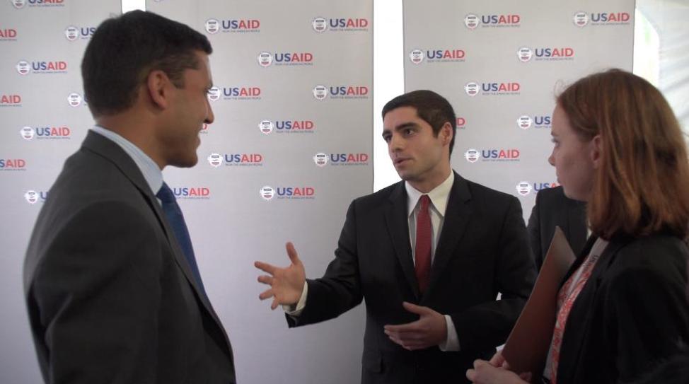 Sam Vaghar sharing MCN with Dr. Rajiv Shah (President, Rockefeller Foundation, former Administrator, USAID).