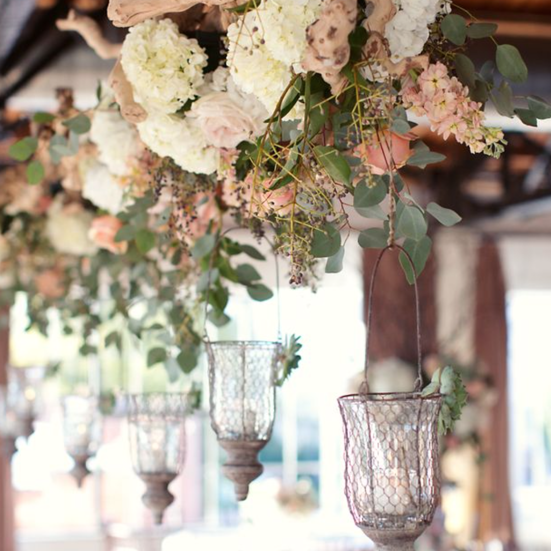 flowing florals and candles scream beauty in my eyes! Photo: Sarah Kate, Style Me Pretty