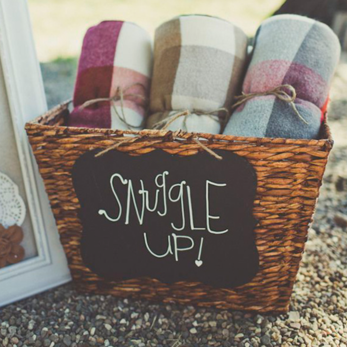 Lovely blanket idea for chilly guests!  Photo: Paper and Lace