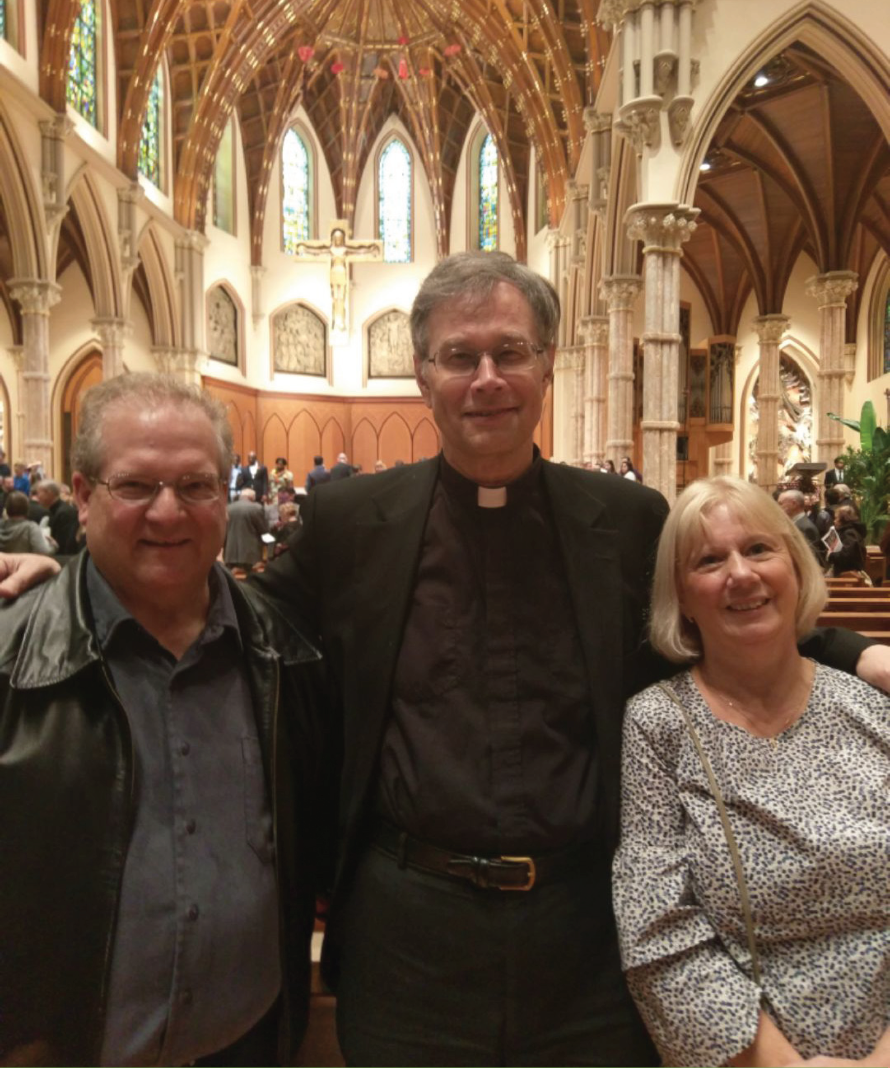 Joe Minneci, Fr. Steve, & Kathy Minneci at Holy Name Cathedral