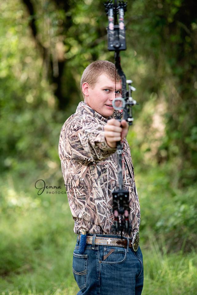 senior boy photos with bow and arrow and camo