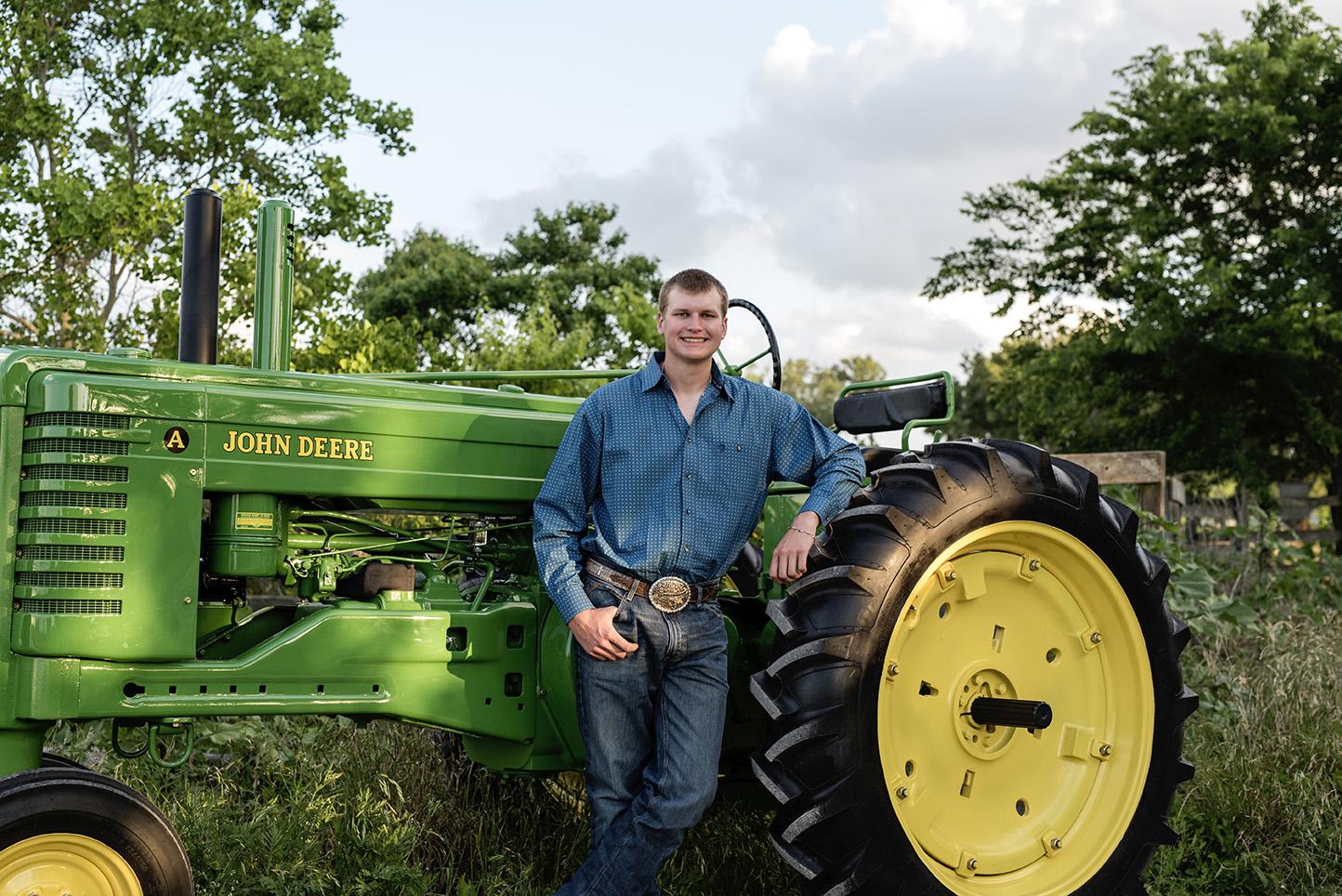 senior boy with restored john deere tractor, photos