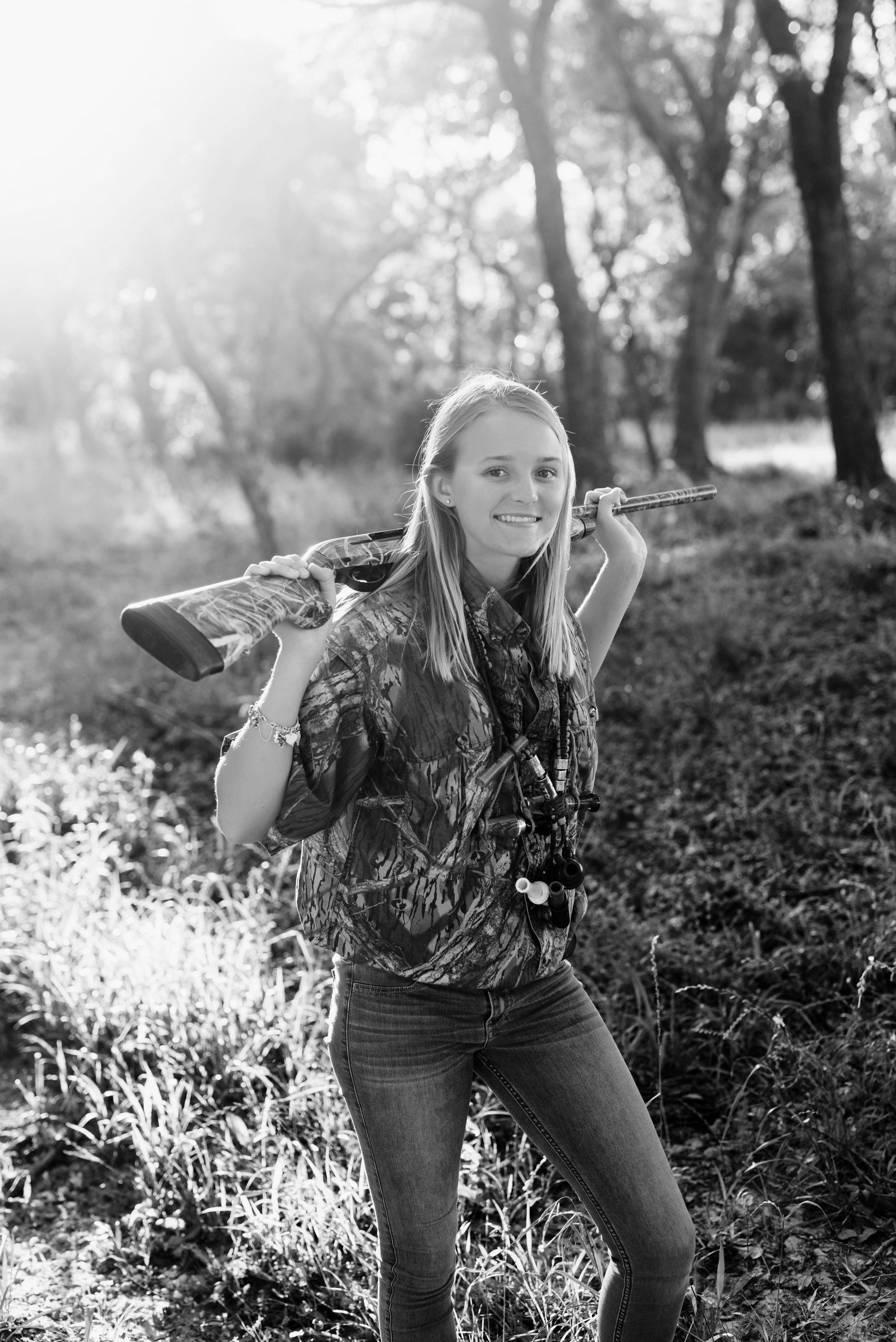 senior girl with gun photos