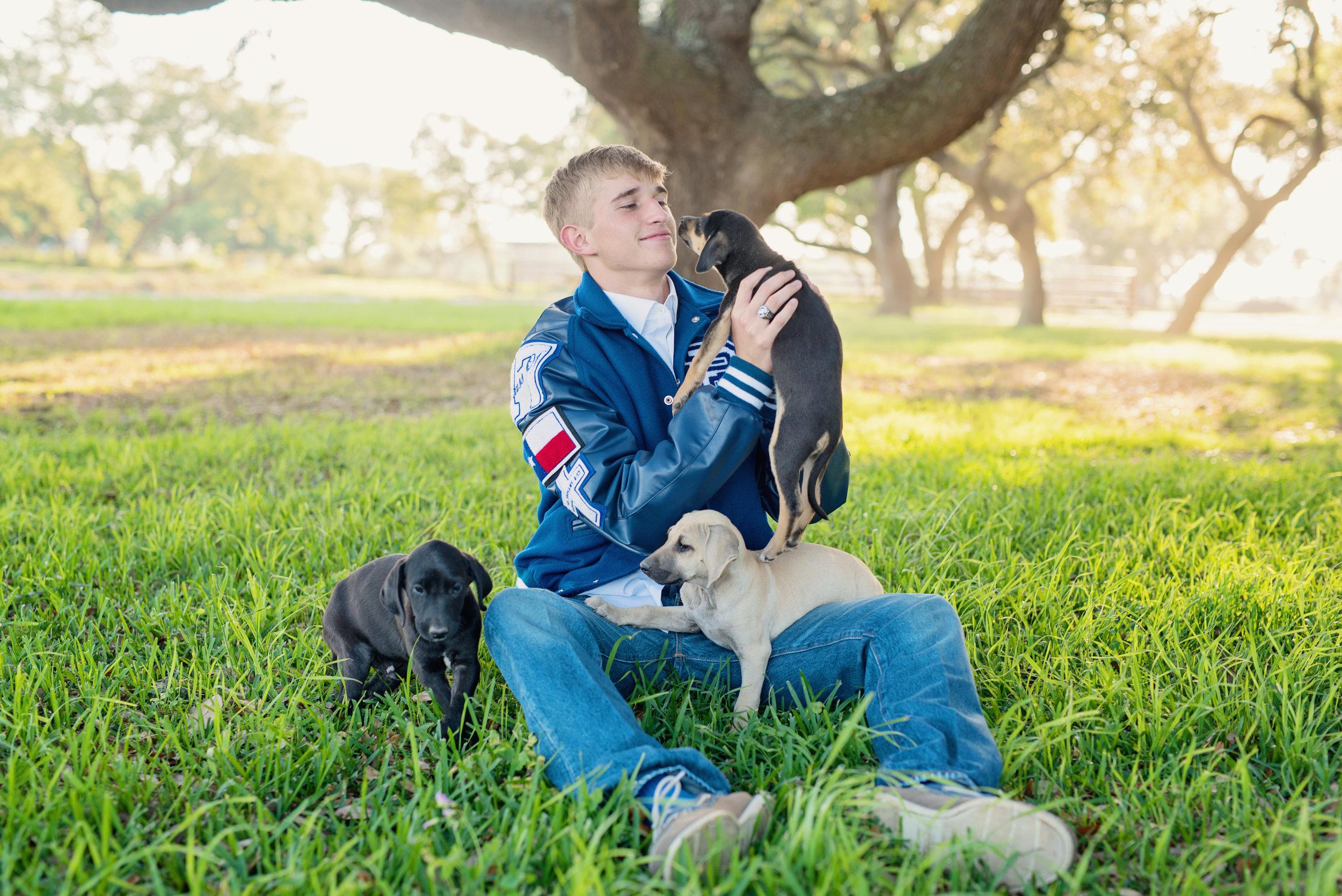 senior boy with puppies photo ideas