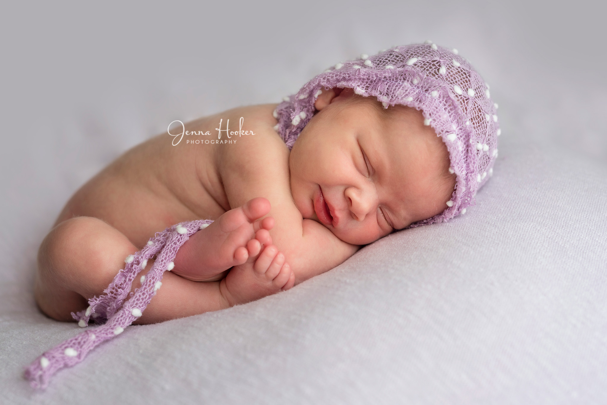 newborn girl with bonnet
