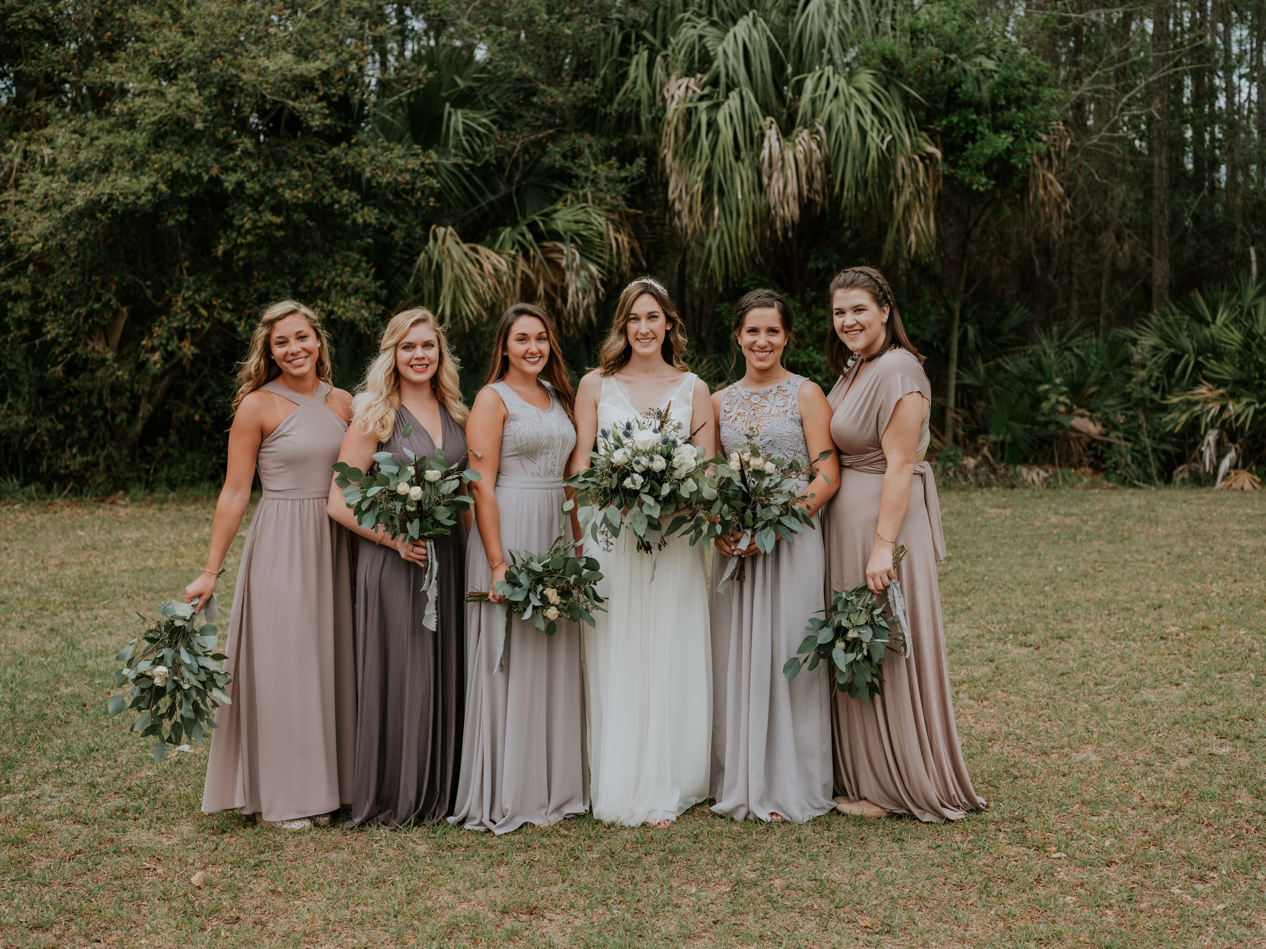 Mismatched Dresses + Colors - These are all different dresses from Lulu's varying in fabric, style, and color! As you can see, given the fluidity of the florals and the overall neutral tones, they all complement each other in a lovely way.
